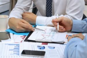 Businesspeople using data